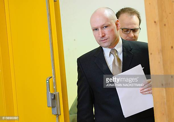Norwegian mass killer Anders Behring Breivik returns to a makeshift court in Skien prisons gym after a lunch break on March 15 2016 in Skien some 130...