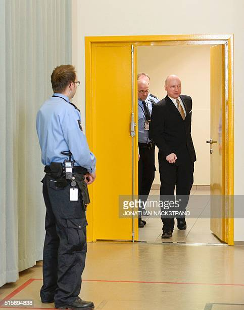 Norwegian mass killer Anders Behring Breivik returns to a makeshift court in Skien prisons gym after a break on March 15 2016 in Skien some 130 km...
