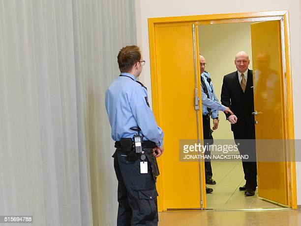 Norwegian mass killer Anders Behring Breivik smiles as he returns to a makeshift court in Skien prisons gym after a break on March 15 2016 in Skien...