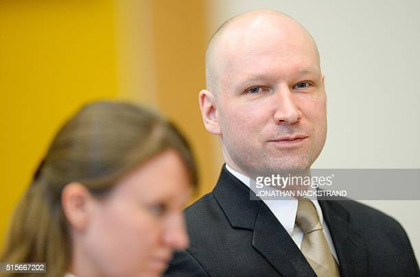 Norwegian mass killer Anders Behring Breivik smiles at a makeshift court in Skien prisons gym on March 15 2016 in Skien some 130 km south west of...