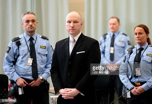 Norwegian mass killer Anders Behring Breivik surrounded by prison guards attends his fourth and last day in court in Skien prison March 18 2016...