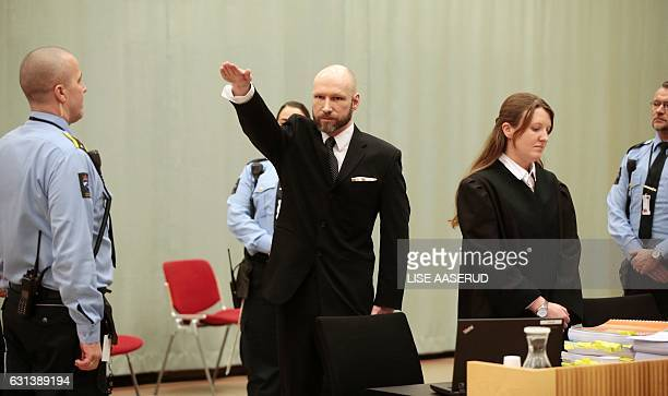 Norwegian mass murder Anders Behring Breivik makes a Nazi salute ahead his appeal hearing at a court at the Telemark prison in Skien Norway on...