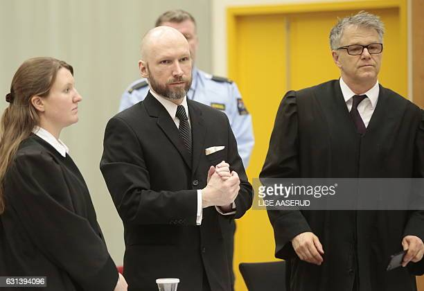 Norwegian mass murder Anders Behring Breivik stands in the courtroom next to his lawyers Mona Danielsen and Oystein Storrvik during the appeal...