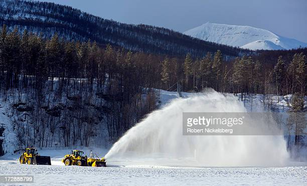 Norwegian military snowblower clears windblown snow near a runway March 5 2013 at the Royal Norwegian Air Force base in Bardufoss Norway Located...