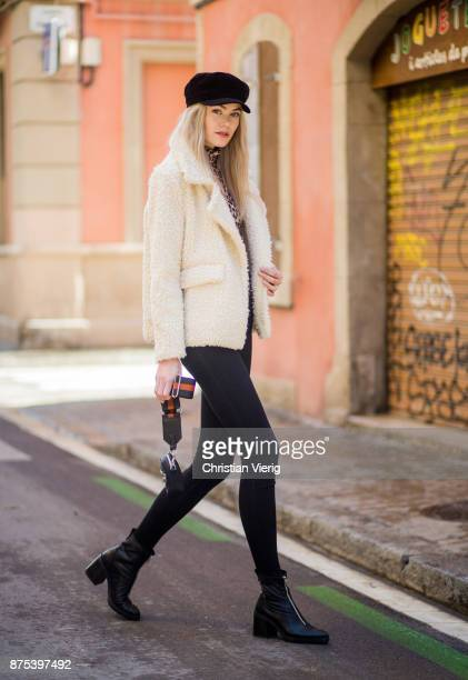 Norwegian model Jeanett Olsen wearing beige teddy jacket Stradivarius sweater with leopard print Ganni black skinny jeans 2nd day black ankle boots...