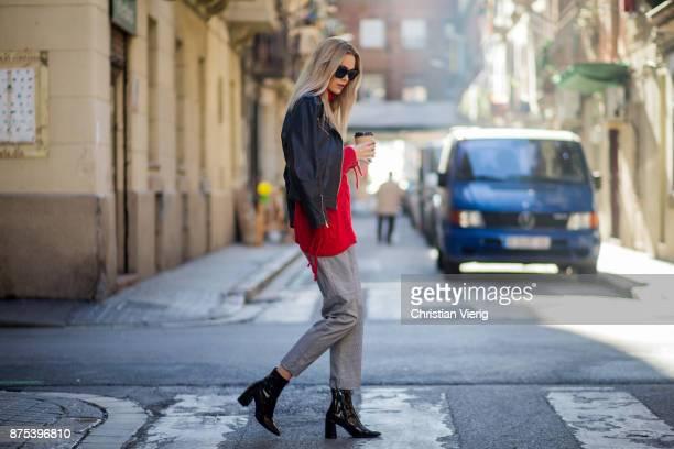 Norwegian model Jeanett Olsen wearing grey checked Lindex pants red Bershka knit black Mango leather jacket black Mango ankle boots sunglasses Quay...