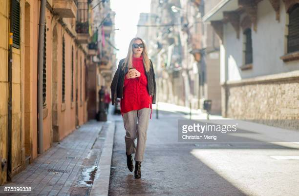 Norwegian model Jeanett Olsen with a coffee to go wearing grey checked Lindex pants red Bershka knit black Mango leather jacket black Mango ankle...