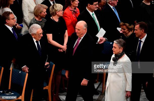 Norwegian Nobel Committee member Berit Reiss-Andersen and King Harald of Norway walk past former US Secretary of State Henry Kissinger as they arrive...