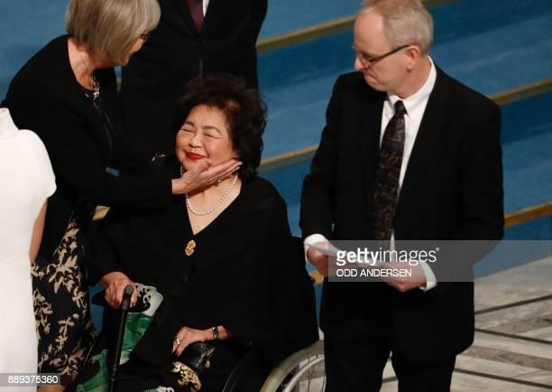 Norwegian Nobel Committee member Henrik Syse looks on as Nobel Committee member Tone Jorstad comforts Hiroshima nuclear bombing survivor Setsuko...
