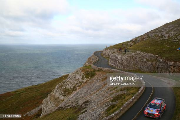 Norwegian pilot Andreas Mikkelsen and co pilot Anders Jaeger of the Hyundau Shell Mobis World Rally Team drive their Hyundai i20 Coupe WRC as they...