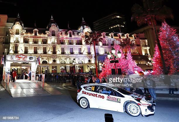 Norwegian pilot Henning Solberg takes the start of the Rallye of MonteCarlo in Monaco on January 22 2015 AFP PHOTO / VALERY HACHE