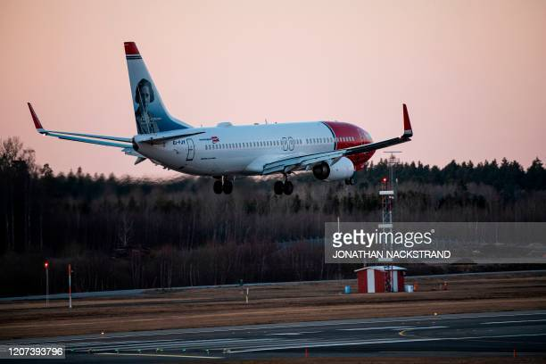 Norwegian plane approaches Arlanda airport, north of Stockholm, on March 16 where air traffic slowed down due to the spread of the novel coronavirus...
