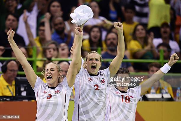 Norwegian players celebrate a goal during the women's semifinal handball match Norway vs Russia for the Rio 2016 Olympics Games at the Future Arena...