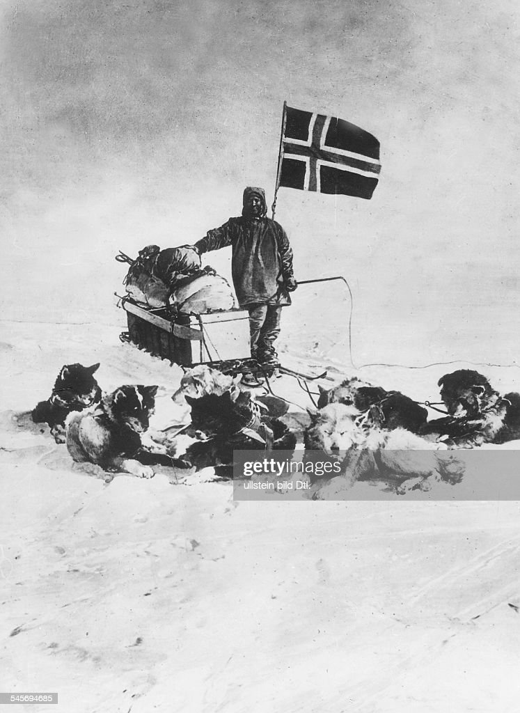 Norwegian polar explorer hoisting the Norwegian flag at the South Pole - December 14, 1911