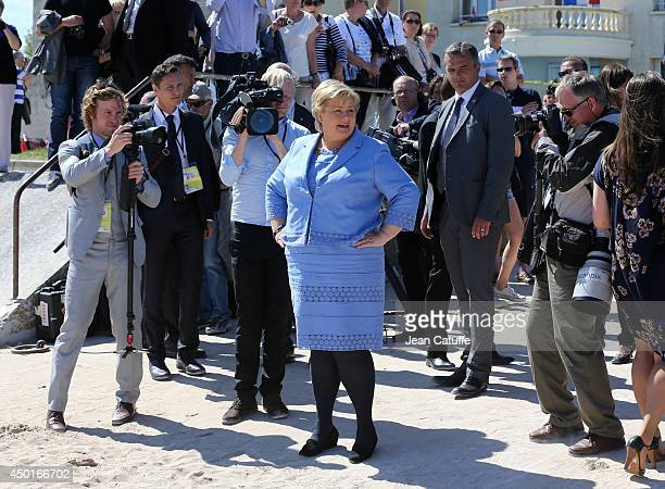 Norwegian Prime Minister Erna Solberg attends a ceremony to commemorate the Norwegian soldiers on the 70th anniversary of DDay on June 6 2014 in...
