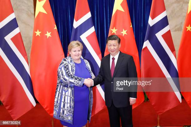 Norwegian Prime Minister Erna Solberg greets Chinese President Xi Jinping at the Great Hall of People on April 10 2017 in Beijing China