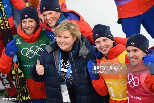 TOPSHOT Norwegian prime Minister Erna Solberg poses for a photograph with gold winners Norway's Martin Johnsrud Sundby Johannes Hoesflot Klaebo Simen...