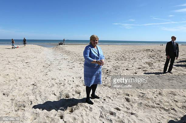 Norwegian Prime Minister Erna Solberg poses on the beach during a ceremony to commemorate the Norwegian soldiers on the 70th anniversary of DDay on...