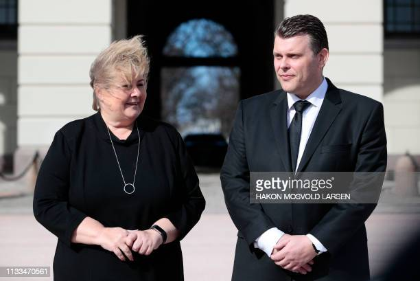 Norwegian Prime Minister Erna Solberg presents newly appointed Minister of Justice Joran Kallmyr outside the Royal Palace in Oslo Norway on March 29...