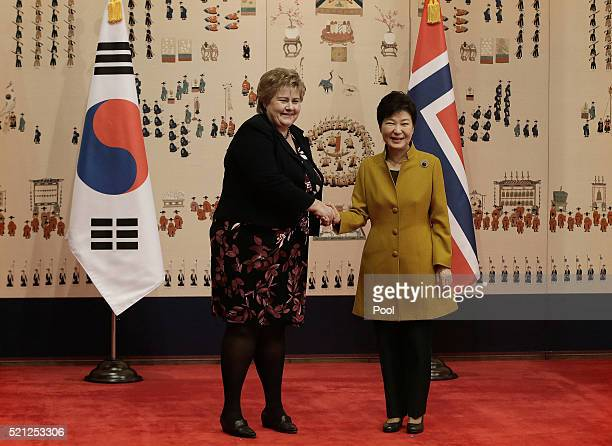Norwegian Prime Minister Erna Solberg shakes hands with South Korean President Park GeunHye during a meeting at the presidential house on April 15...