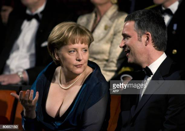 Norwegian Prime Minister Jens Stoltenberg and German Chancellor Angela Merkel speak on April 12 2008 during the inauguration of the new opera...