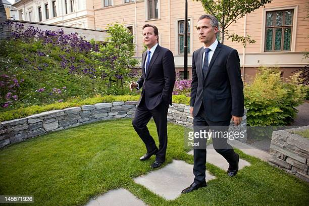 Norwegian Prime Minister Jens Stoltenberg and his British colleague David Cameron arrive for a press briefing in the garden of the Norwegian Prime...
