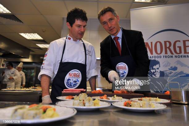 Norwegian Prime Minister Jens Stoltenberg looks at the camera while cooking with Norway Kitchen Academy Manager Jostein Medhus before a lunch meeting...