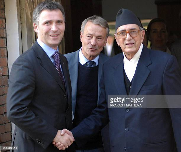 Norwegian Prime Minister Jens Stoltenberg shakes hands with Nepalese Prime Minister Girija Prasad Koirala as Norwegian Ambassador Tore Toreng looks...