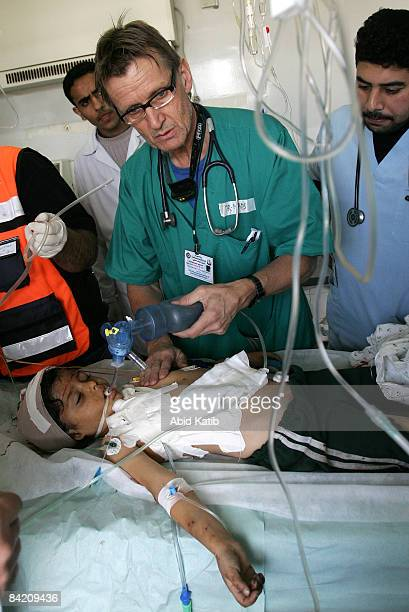 Norwegian professor Dr Mads Gilbert the head of department of emergency medical services in the University Hospital of North Norway center tends with...