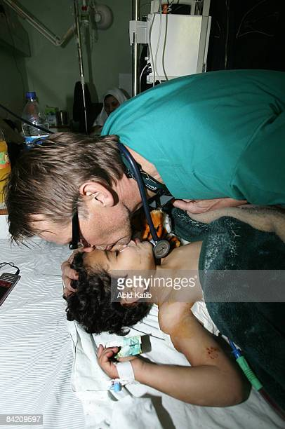Norwegian professor Dr Mads Gilbert the head of department of emergency medical services in the University Hospital of North Norway center tends a...
