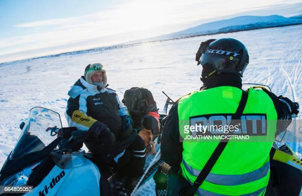 Norwegian reindeer police officer Jim Hugo Hansen talks with a local Sami during a patrol at the Finnmark county located in the northeastern part of...