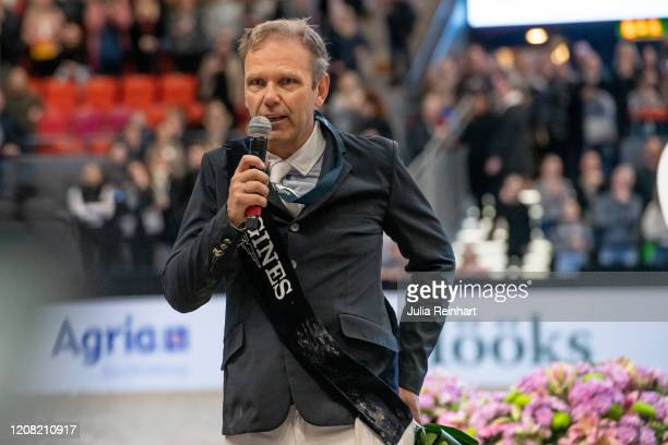 Norwegian rider Geir Gulliksen addresses the public after falling off his horse during the price winning ceremony for the FEI World Cup Jumping event...