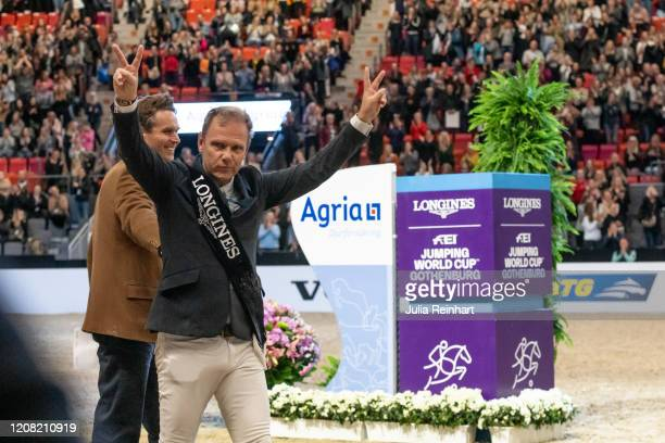 Norwegian rider Geir Gulliksen waves to the audience after falling off his horse during the price winning ceremony for the FEI World Cup Jumping...