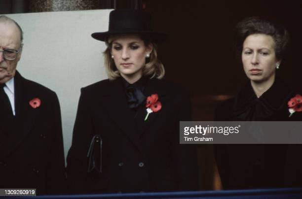Norwegian Royal Olav V of Norway alongside British Royals Princess Diana and Anne, Princess Royal, each wearing a remembrance poppy, at the...