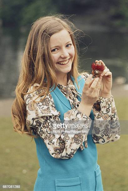 Norwegian singer Hanne Krogh posed holding a small toy before performing the song 'Lykken er' on stage for Norway in the 1971 Eurovision Song Contest...