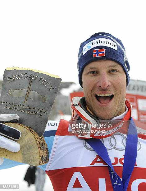 Norwegian skier Aksel Lund Svindal celebrates holding his trophy after winning the in the FIS World Cup Men's Downhill race, in Beaver Creek,...