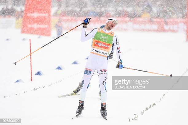 Norwegian skier Jan Schmid reacts as he wins the individual Gundersen of the FIS Ski Nordic Combined World Cup on January 20 2018 in ChauxNeuve...