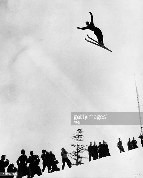 Norwegian skier Ruud Birger makes his winning jump before spectators at the Men's Ski Jump event during the IV Winter Olympic Games February 16...