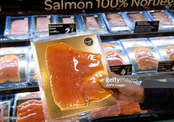 Norwegian Smoked salmon are seen displayed for sale at the Carrefour supermarket in Spain