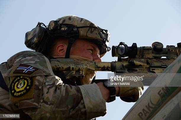 A Norwegian soldier part of NATOled International Security Assistance Force looks through his scope during a clash between insurgents and Afghan...