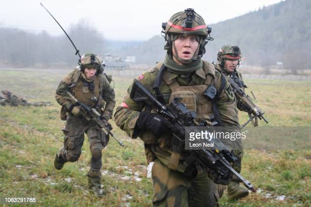Norwegian soldiers run for cover during an attempt to storm an opposing British Army position during the live exercise on November 3 2018 in Elval...