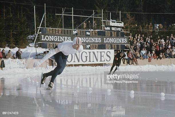 Norwegian speed skater Fred Anton Maier pictured left in competition in the 1969 European Speed Skating Championships event on an ice covered long...
