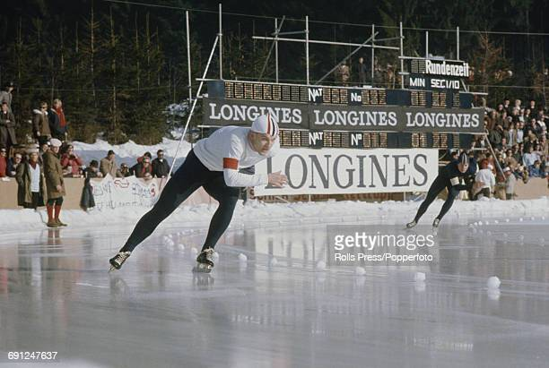 Norwegian speed skater SveinErik Stiansen pictured left in competition in the 1969 European Speed Skating Championships event on an ice covered long...
