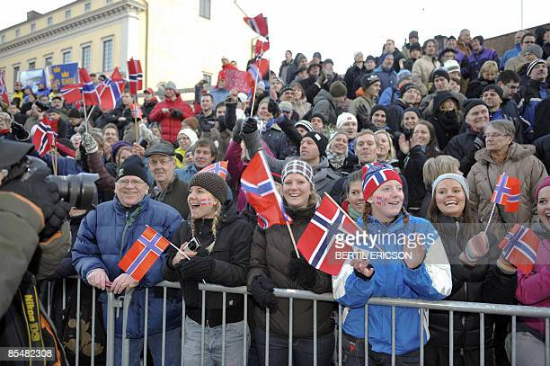 Norwegian supporters celebrate after winner Johan Kjoelstad 2nd placed John Kristian Dahl and 3rd placed Eldar Roenning of Norway won in the final of...