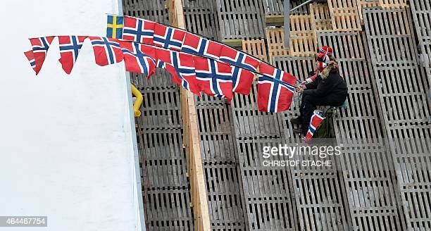 Norwegian supporters follow the Nordic Combined ski jumping competition in the ski stadium of the 2015 FIS Nordic World Ski Championships in Falun...