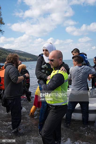 Norwegian volunteer assisting arriving refugees on Lesbos