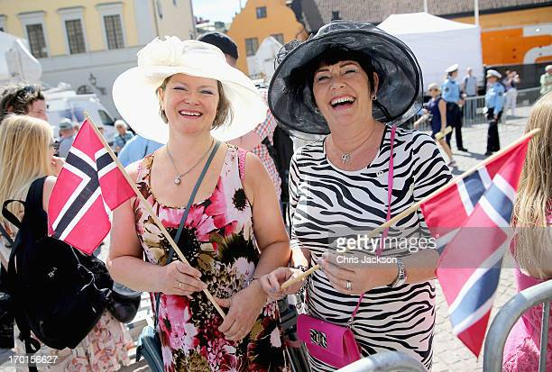 Norwegian women wave flags outside the Royal Palace ahead of the wedding of Princess Madeleine of Sweden and Christopher O'Neill that will take place...