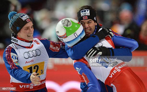 Norwegian's Anders Fannemel Rune Velta and Anders Bardal celebrate after the Men Large Hill Team competition of the 2015 FIS Nordic World Ski...