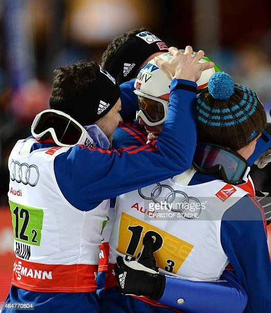 Norwegian's Anders Jacobsen Anders Bardal Rune Velta and Anders Fannemel celebrate after the Men Large Hill Team competition of the 2015 FIS Nordic...