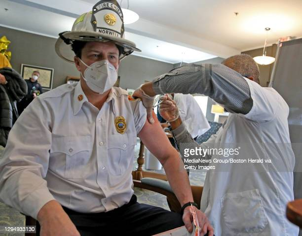 January 6: Norwell Chief Jeff Simpson gets his COVID-19 vaccine at the Royal Health Group on January 6, 2021 in Norwell, Massachusetts.